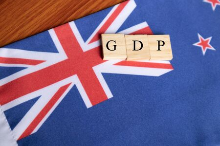 Gross Domestic product or GDP of Australia In wooden block letters on Australian Flag Stock Photo