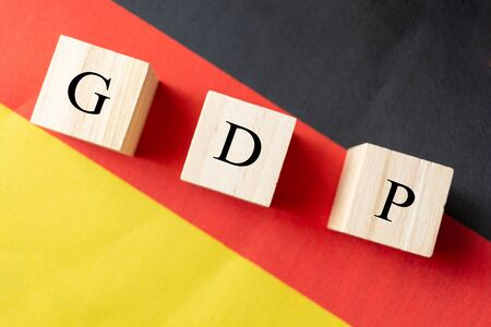 Concept of Gross Domestic Product or GDP of Germany, GDP in wooden block letter on German Flag 写真素材 - 130041713