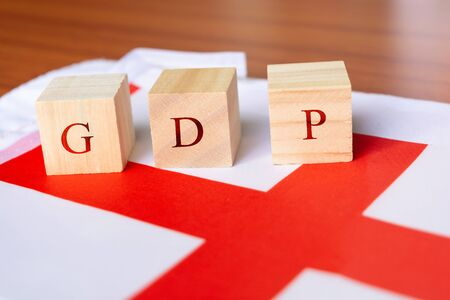 Concept of Gross Domestic Product or GDP of England, GDP in wooden block letter on England Flag 写真素材 - 130041717