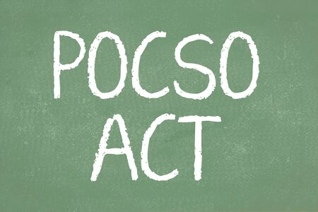 POCSO ACT is a law to Protect the Children from Sexual Offences in India written on green chalkboard Stock Photo