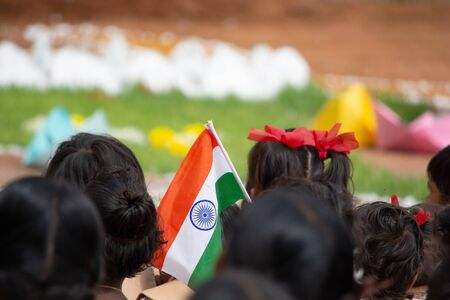 School children sat ground by holding Indian flag in hand during Independence day of India Stock fotó