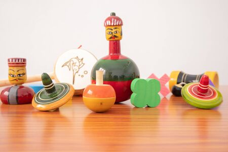 Colourful different types of GI Tagged channapatna toys on table with isolated background Stock fotó
