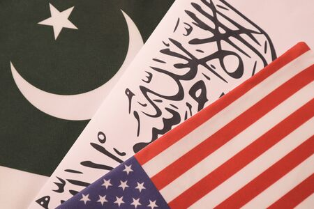 Concept showing of US, Pakistan and Taliban deal preocess showing with flags