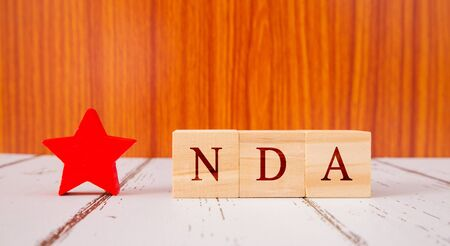Concpet of NDA exam conducted in India for recruitment on Wooden block letters
