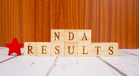 Concpet of NDA exam conducted in India for recruitment, NDA Exam results on Wooden block letters