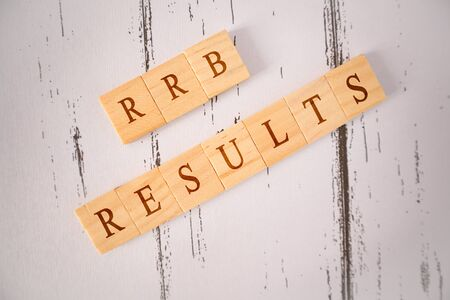 Concpet of RRB exam conducted in India for recruitment, RRB Exam results on Wooden block letters Stok Fotoğraf - 129828804