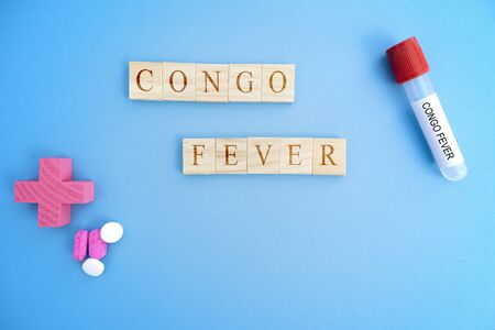 Cocept of Crimean Congo hemorrhagic fever, congo Fever or CCHF in wooden block letters with laboratory tubes 版權商用圖片