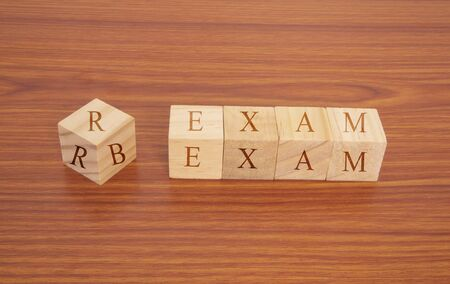Concpet of RRB exam conducted in India for recruitment, RRB Exam on Wooden block letters.