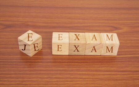 Concept showing of JEE or Joint Entrance Examination conducted in India for recruitment on Wooden block letters. Фото со стока