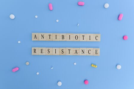 Concept showing of Antibiotic resistance with medicines or pills in wooden block letters.