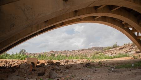 Hampi, India July 8, 2019 : Abandoned and disused bridges near Hampi India Редакционное