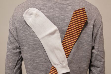 Due to Static Cling socks and tie sticked or attracted to tshirt. Imagens