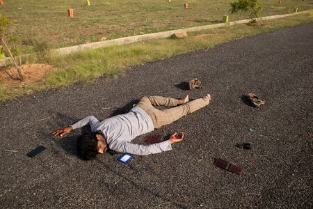 Concept of Crime scene, Wide angle shot of victim dead body laying on Road 版權商用圖片