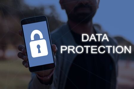 Cybersecurity and data protection concept with a person showing smartphone screen with lock symbol. Zdjęcie Seryjne