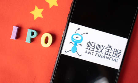 Maski, India - November 5, 2020 : IPO with ANT financial logo in mobile on China Flag. 新闻类图片