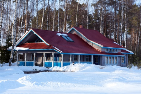 A wooden house in the winter forest Stock Photo - 12355021