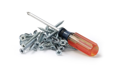 A small red screwdriver and many wood screws isolated on white Stock Photo - 8937234