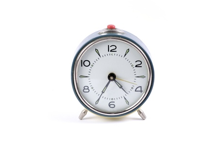 Old blue alarm clock on a white background photo