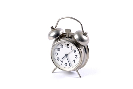 Alarm clock isolated on white photo