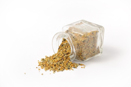 Honeybee pollen granules in glass jar photo