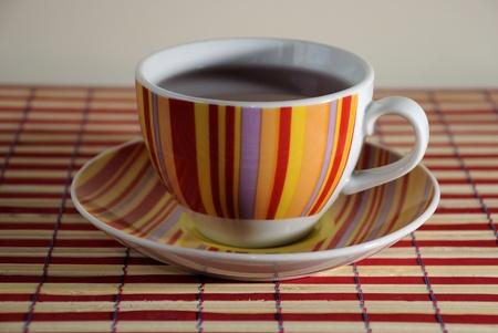 Large red, yellow, purple and orange striped coffee mug Stock Photo - 9075107