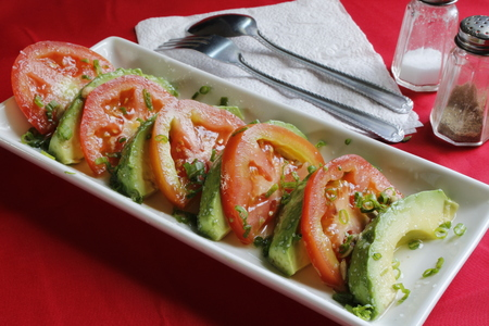 AvocadoTomato Salad with fresh squeezed lemon juice, rock salt and thinly sliced green onions