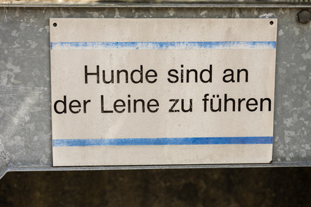 dog on leash sign in german