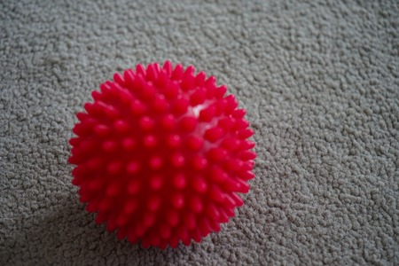red massage ball with spikes