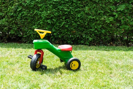vintage bobby car in meadow play toy kids classic fun Stock Photo