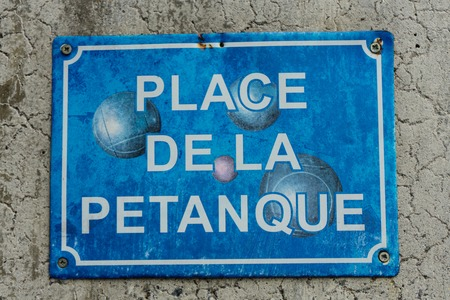 petanque boule sign in washed out blue