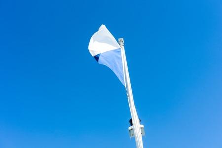 flag of zurich switzerland with blue sky
