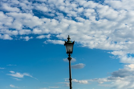 old vintage light pole and sky with clouds