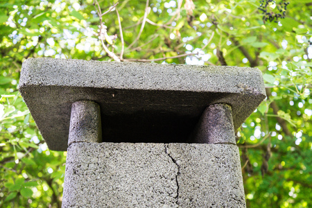 winter grilling: vintage grill chimney with concrete crack