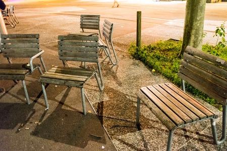 chairs standing randomly around in the night