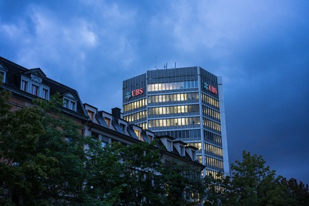 UBS Bank Office Building in Zurich, Switzerland at Night with Sky and Clouds, EDITORIAL USE ONLY