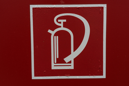 fire extinguisher sign retro style on red background in white lines