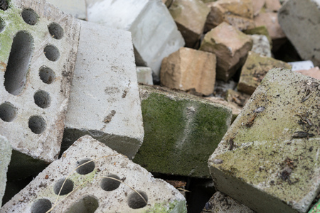 concrete bricks construction material laying in skip on each other heap
