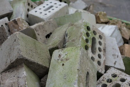 saltar: concrete bricks construction material laying in skip on each other heap