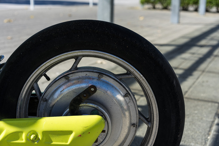 back wheel tire and brakes of a motorbike scooter