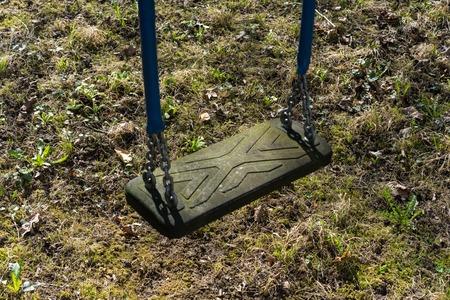 empty old swing on playground Stock Photo
