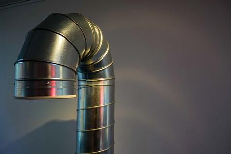 grey steel tube of industrial vent pipe, indoor view