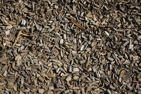 Brown wood shingles on ground, full frame for background