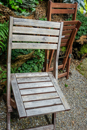 Two wooden chairs in garden, outdoor furniture 写真素材