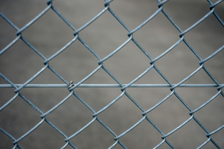 Grey iron fence, abstract close up view with concrete background