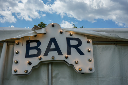 Bar sign with light bulps on tent