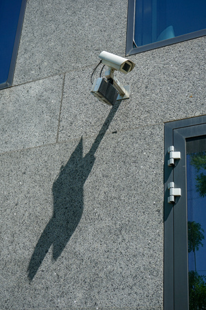 CCTV camera for surveillance on grey wall