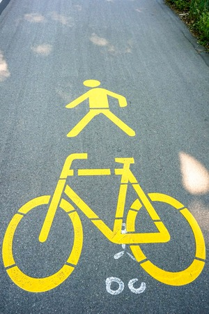 Yellow bicycle and pedestrian markings on street