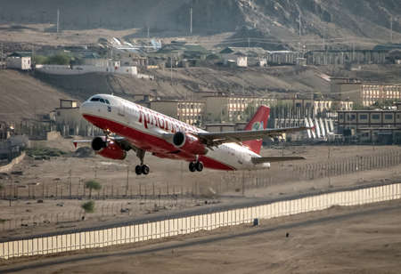 Leh, Jammu and Kashmir, India - June 26, 2011 : Kingfisher Airlines airbus A-320 # VT-DKR takes off from Leh