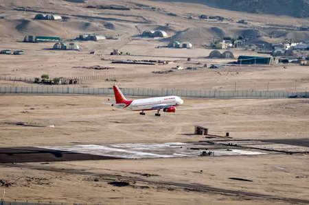 Leh, Jammu and Kashmir, India - June 26, 2011 : Air india airbus touches down at Leh airport