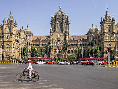 Mumbai, Maharashtra, India-February 01, 2018 : Mumbai Dabbawala in front of Heritage building of Victoria Terminus Railway station - CSMT.